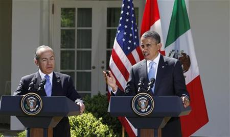 U.S. President Barack Obama, (R), and Mexico's President Felipe Calderon (L) hold a joint press conference in the Rose Garden of the White House in Washington, April 2, 2012. REUTERS/Larry Downing