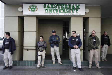Federal agents guards the entrance after conducting a raid on Oaksterdam University, a cannabis cultivation college in Oakland, California April 2, 2012. REUTERS/Stephen Lam
