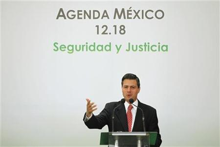 Enrique Pena Nieto, presidential candidate for the opposition Institutional Revolutionary Party (PRI), speaks during a meeting on ''Agenda Mexico 12.18, security and justice'' in Mexico city April 2, 2012. REUTERS/Edgard Garrido