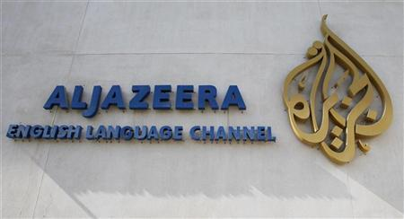 The logo of Qatar-based Al Jazeera satellite news channel is seen in Doha February 7, 2011. REUTERS/ Fadi Al-Assaad