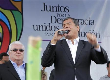 Ecuadorean President Rafael Correa addresses to his supporters who gathered in the Arbolito Park in Quito, March 22, 2012. REUTERS/Guillermo Granja