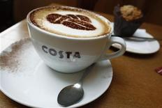 A cup of cappuccino stands on a table at a branch of Costa coffee in Knutsford, northern England, September 10, 2010. REUTERS/Phil Noble