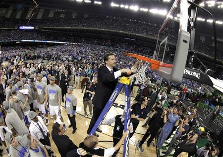 Kentucky Wildcats head coach John Calipari cuts down the net after the Wildcats defeated the Kansas Jayhawks to win the men's NCAA Final Four championship college basketball game in New Orleans, Louisiana, April 2, 2012. REUTERS/Lucy Nicholson
