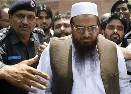 Police escort Hafiz Saeed in Lahore May 5, 2009. REUTERS/Mohsin Raza/Files