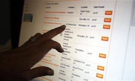 A woman points to a job listing on an employment website at her residence in Sewell, New Jersey, July 7, 2011. REUTERS/Tim Shaffer