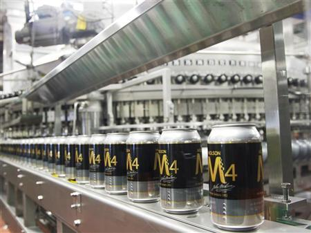 Cans of Molson beer are seen on a production line during a news conference in Montreal, March 19, 2012. REUTERS/Christinne Muschi