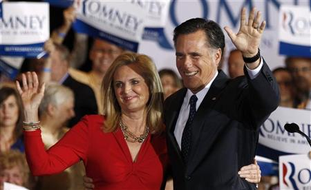 Republican presidential candidate Mitt Romney waves to supporters with his wife Ann during his Illinois primary night rally in Schaumburg, Illinois, March 20, 2012. REUTERS/Jim Young