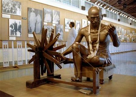 A life sized statue of Mahatma Gandhi occupies centre stage at an exhibition in Mumbai August 14, 1997. REUTERS/Savita Kirloskar/Files