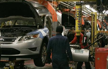 Workers place tires on the 2011 Ford Explorer and other vehicles at the Ford assembly plant in Chicago, Illinois, December 1, 2010. REUTERS/Frank Polich/Files