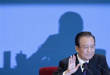 China's Premier Wen Jiabao gestures as he delivers a speech at a news conference after the closing ceremony of the National People's Congress (NPC) at the Great Hall of the People in Beijing March 14, 2012. REUTERS/Jason Lee