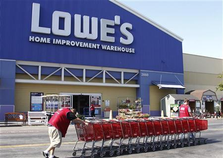 Lowe's workers collect shopping carts in the parking lot at the Lowe's Home Improvement Warehouse in Burbank, California August 15,2011. REUTERS/Fred Prouser