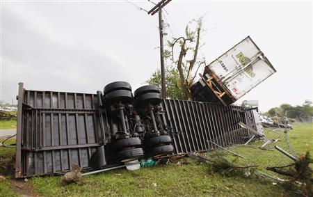 Semi-tractor trailers lay in debris left by a tornado which passed through the southern area of Dallas, Texas April 3, 2012.Tornadoes tore through the Dallas-Fort Worth metropolitan area in Texas on Tuesday, ripping apart buildings, tossing tractor trailer trucks into the air and grounding all planes in the region.There were no immediate reports of injuries or deaths although the storm was still active. REUTERS/Tim Sharp
