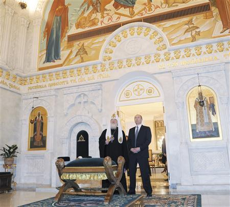 Russian Prime Minister Vladimir Putin (R) and Patriarch of Moscow and All Russia Kirill visit the restored rooms of Svyato-Danilov Monastery, the headquarters of the Russian Orthodox church, in Moscow February 1, 2012. REUTERS/Yana Lapikova/RIA Novosti/Pool