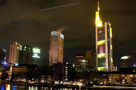 The logo of the Eurohypo bank is projected on to the facade of Commerzbank's headquarters in downtown Frankfurt, central Germany April 2, 2006. REUTERS/Kai Pfaffenbach