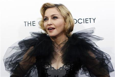 Madonna poses for photographers as she arrives for the premiere of the film ''W.E.'' which she directed, at the Ziegfeld Theater in New York City, January 23, 2012. REUTERS/Mike Segar