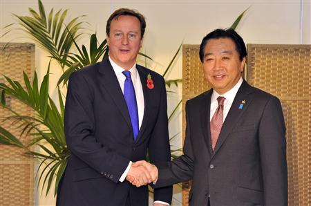 Britain's Prime Minister David Cameron (L) shakes hands with Japan's Prime Minister Yoshihiko Noda ahead of a bilateral meeting before the start of the G20 Summit of major world economies in Cannes November 3, 2011. REUTERS/Toby Melville