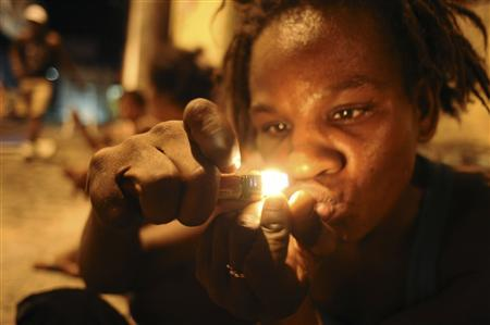 A drug user consumes crack in the old center of Salvador da Bahia March 19, 2012. REUTERS/Lunae Parracho