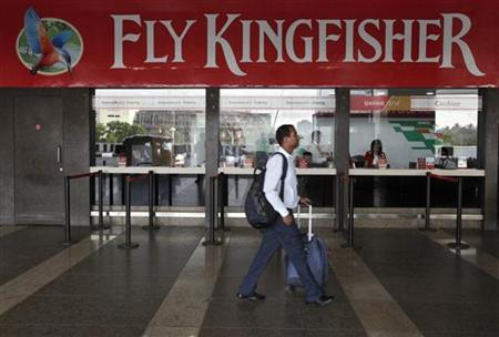 A passenger walks past a near-empty Kingfisher airlines ticketing office at Mumbai's domestic airport March 27, 2012. REUTERS/Vivek Prakash