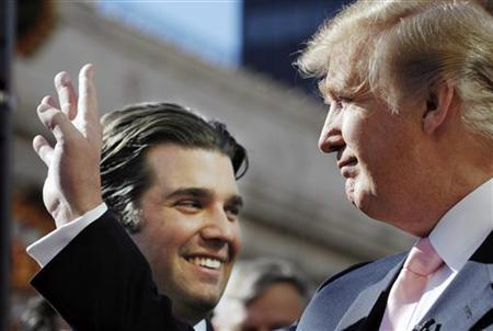 Donald Trump (R) waves to a fan as his son Donald Jr. looks on after Trump received a star on the Hollywood Walk of Fame in Los Angeles January 16, 2007. REUTERS/Chris Pizzello