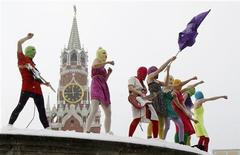 Members of the Russian radical feminist group 'Pussy Riot' sing a song at the so-called Lobnoye Mesto (Forehead Place), long before used for announcing Russian tsars' decrees and occasionally for carrying out public executions, in Red Square in Moscow January 20, 2012. Eight activists, who were later detained by police, staged a performance to protest against the policies conducted by Prime Minister Vladimir Putin. REUTERS/Denis Sinyakov