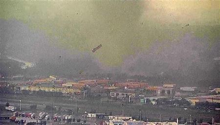 A trailer flies through the air as a tornado sweeps through the Dallas-Fort Worth area April 3, 2012 in this still image taken from video. REUTERS/Reuters TV/NBC/Handout