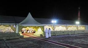 A Qatari wedding takes place in a traditional marriage tent in Doha March 27, 2012. REUTERS/Mohammed Dabbous