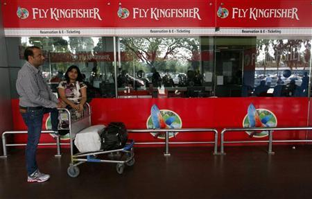 Passengers stand at a Kingfisher Airlines reservation office at the domestic airport in Kolkata February 21, 2012. REUTERS/Rupak De Chowdhuri/Files