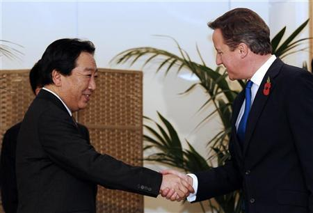 Britain's Prime Minister David Cameron (R) shakes hands with Japan's Prime Minister Yoshihiko Noda ahead of a bilateral meeting before the start of the G20 Summit of major world economies in Cannes November 3, 2011. REUTERS/Kerim Okten/Pool