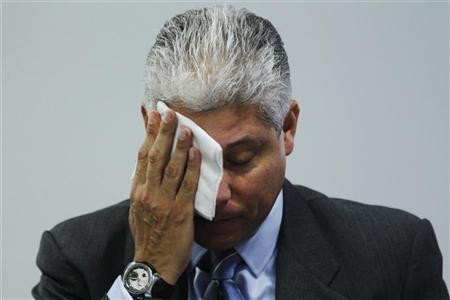 Chevron's Director of Corporate Affairs in Brazil, Rafael Jaen Williamson, wipes his face as he speaks about the oil leak that seeped off the coast of Rio de Janeiro into the waters of the Campos Basin, caused by a well drilled by Chevron at Frade, during a meeting with the environmental commission of the federal senate in Brasilia March 22, 2012. REUTERS/Ueslei Marcelino