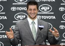 New York Jets quarterback Tim Tebow speaks at a news conference introducing him as a Jets at the team's training center in Florham Park, New Jersey March 26, 2012. Tebow was traded to the Jets from the Denver Broncos last week. REUTERS/Ray Stubblebine