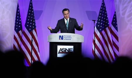 Former Governor of Massachusetts Mitt Romney gestures during the Newspaper Association of America/American Society of Newspaper Editors annual luncheon in Washington, April 4, 2012. REUTERS/Larry Downing