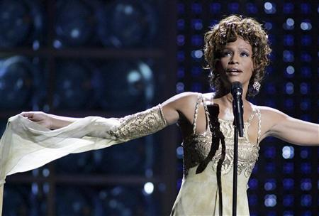Whitney Houston performs during the World Music Awards at the Thomas & Mack Center in Las Vegas, Nevada as a tribute to music mogul Clive Davis, who received the Outstanding Contribution to the Music Industry Award, in this September 15, 2004 file photo. Houston died of accidental drowning due to the effects of cocaine use and heart disease, a Los Angeles County coroner's spokesman said on March 22, 2012. REUTERS/Ethan Miller/Files