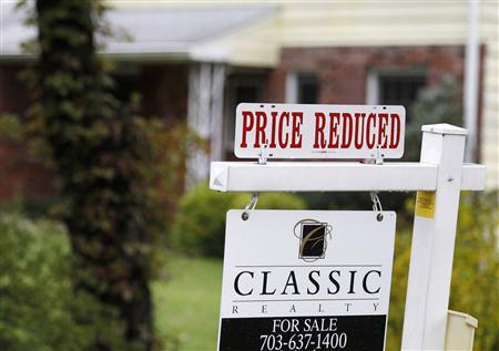 A ''Price Reduced'' sign is displayed on a home for sale in northern Virginia suburb of Vienna, outside Washington in this file photo taken October 27, 2010. REUTERS/Larry Downing/Files