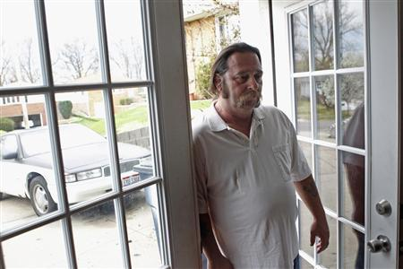 Daniel Burns, 52, stands in the doorway of his home in Garfield Heights, Ohio March 23, 2012. Unable to cover his mortgage, Burns received a grant from a government fund using money repaid from the 2008 bank bailout. Half a decade into the deepest U.S. housing crisis since the 1930s, many Americans are hoping the crisis is finally nearing its end. But a painful part two of the slump looks set to unfold: Many more U.S. homeowners face the prospect of losing their homes this year as banks pick up the pace of foreclosures. Picture taken March 23, 2012. REUTERS/Matt Sullivan