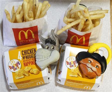 Two McDonald's Happy Meal with toy watches fashioned after the characters Donkey and Puss in Boots from the movie ''Shrek Forever After'' are pictured in Los Angeles June 22, 2010. REUTERS/Mario Anzuoni