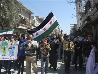 Demonstrators protest against Syria's President Bashar Al-Assad in Kafranbel, near Idlib April 3, 2012. Picture taken April 3. REUTERS/Raad Al Fares/Shaam News Network/Handout
