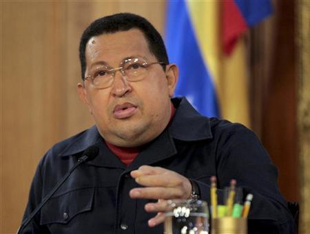 Venezuela's President Hugo Chavez talks at Miraflores Palace in Caracas March 31, 2012. REUTERS/Miraflores Palace/Handout