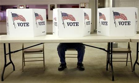 A voter casts a ballot at the Flushing Volunteer Fire Department in Flushing, Ohio, March 6, 2012. REUTERS/Matt Sullivan