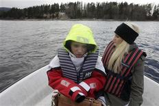 Survivor Alexandra Peltre (L) and her friend Andrea Markussen travel by boat to Utoeya island, northwest of Oslo April 2, 2012. REUTERS/Ints Kalnins
