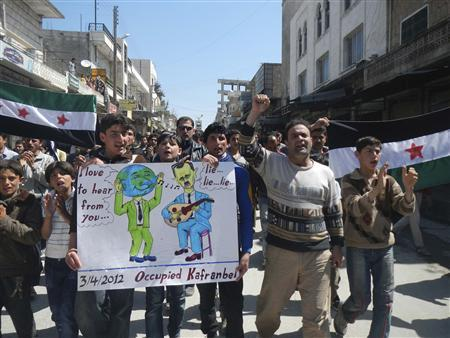 Demonstrators protest against Syria's President Bashar Al-Assad in Kafranbel, near Idlib April 3, 2012. REUTERS/Raad Al Fares/Shaam News Network/Handout