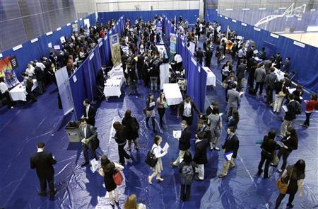 American University students walk among recruiting booths during a career job fair at American University in Washington March 28, 2012. REUTERS/Jose Luis Magana