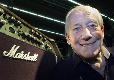 Jim Marshall, builder of amplifiers poses with one of his products at the 'Musikmesse' in Frankfurt March 13, 2002. REUTERS/Ralph Orlowski/Files