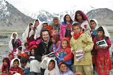 "Greg Mortenson poses with Sitara ""Star"" schoolchildren in Wakhan, northeastern Afghanistan in this undated handout photograph released to Reuters March 11, 2009. REUTERS/Central Asia Institute/Handout"