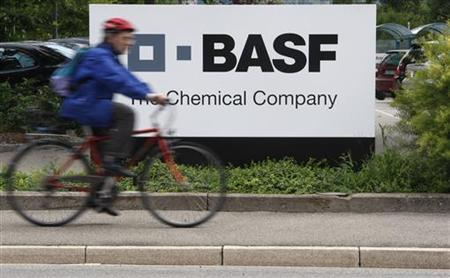 A cyclist rides his bike past the entrance of the BASF plant and former Ciba production site in Schweizerhalle near Basel July 7, 2009. REUTERS/Christian Hartmann