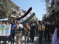 Demonstrators protest against Syria's President Bashar Al-Assad in Kafranbel, near Idlib April 3, 2012. REUTERS/Raad Al Fares/Shaam News Network/Handout