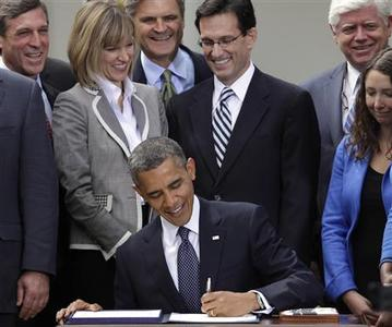 U.S. President Barack Obama signs the Jumpstart Our Business Startups (JOBS) Act in the Rose Garden of the White House in Washington April 5, 2012. REUTERS/Yuri Gripas