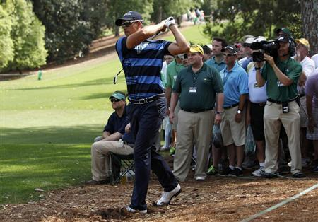 Henrik Stenson of Sweden hits his third shot from the pine needles on the 18th hole during first round play in the 2012 Masters Golf Tournament at the Augusta National Golf Club in Augusta, Georgia, April 5, 2012. REUTERS/Mike Segar