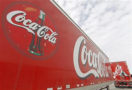 Trucks containing cases of Coca-Cola, which will be delivered to stores, sit outside a warehouse at the Swire Coca-Cola facility in Draper, Utah March 9, 2011. REUTERS/George Frey