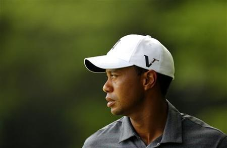 Tiger Woods of the U.S. waits on the 13th green after sinking a par putt during first round play in the 2012 Masters Golf Tournament at the Augusta National Golf Club in Augusta, Georgia, April 5, 2012. REUTERS/Brian Snyder