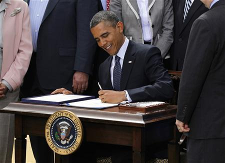 U.S. President Barack Obama signs the Jumpstart Our Business Startups (JOBS) Act in the Rose Garden of the White House in Washington, April 5, 2012. REUTERS/Jason Reed